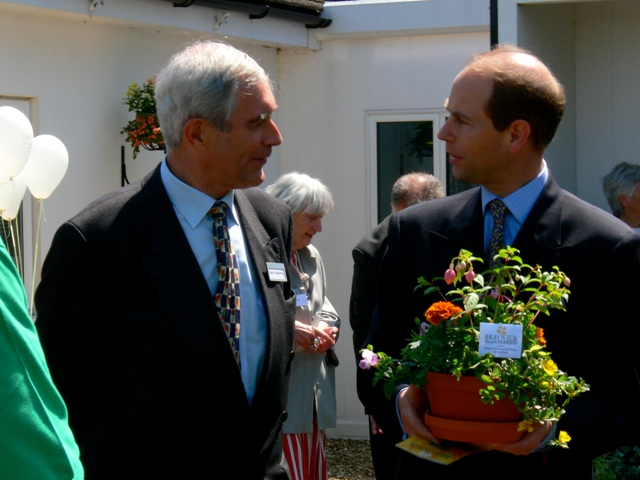 Robin presenting Prince Edward with plants